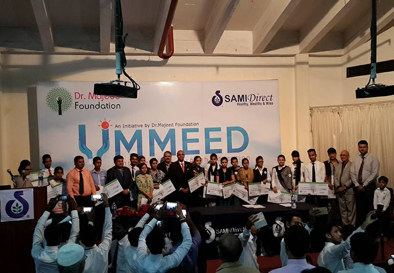 Dr. Majeed Foundation Distributed the Cheques to the Needy Students as Educational Assistance Under Its Project 'UMMEED'. Mr. Shaheen Majeed - Markteing Director Sami Sabinsa Group Was the Chief Guest